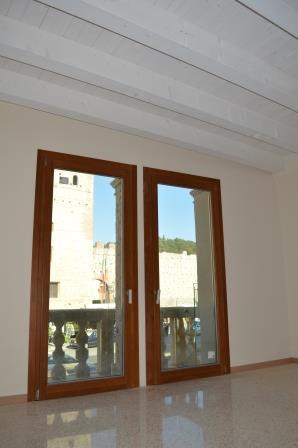 serramenti legno alluminio per palazzo corner